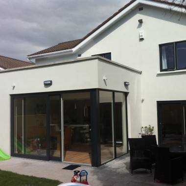 Flat roof, modern extension.